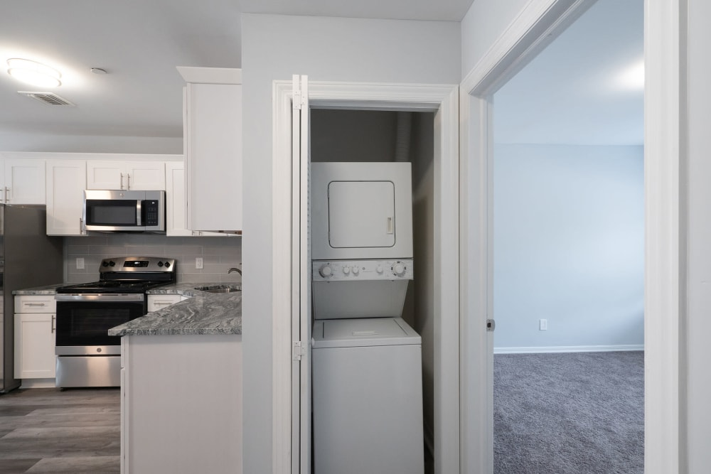 Kitchen with washer and dryer nearby at Bunt Commons II in Copiague, New York