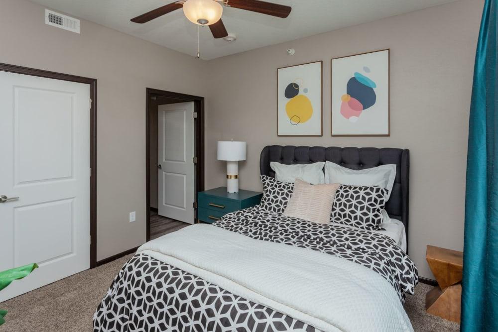 Bright primary bedroom at Autumn Ridge in Waukee, Iowa
