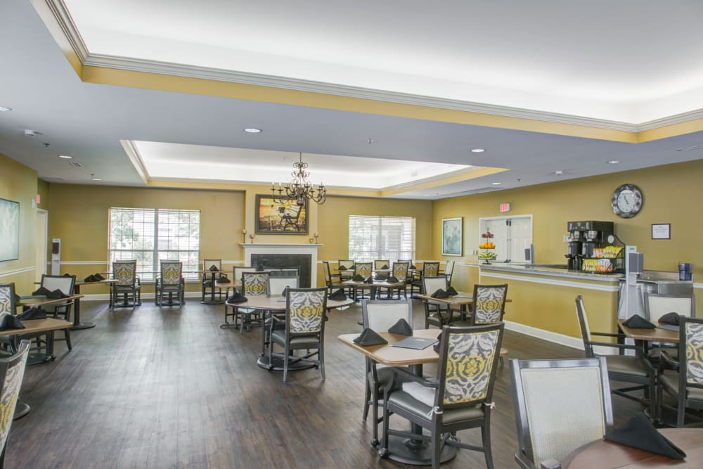 Interior of well lit dining room at Truewood by Merrill, Riverchase in Hoover, Alabama.
