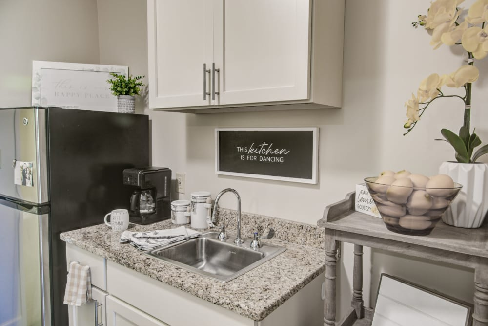 Kitchen space with stainless steel refrigerator at Truewood by Merrill, Riverchase in Hoover, Alabama.