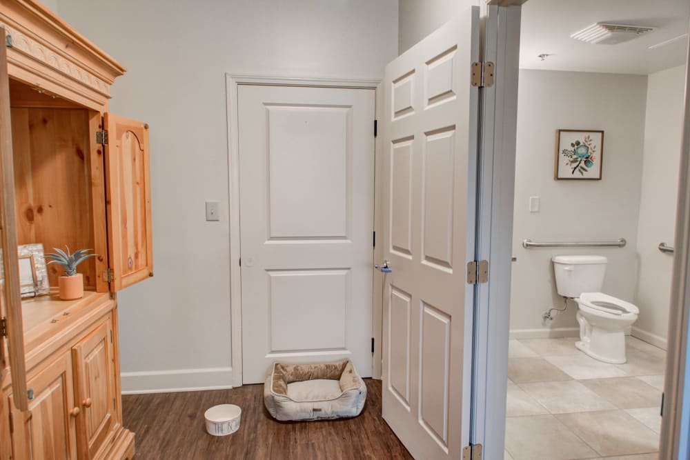 Apartment entrance and bathroom doorway at Truewood by Merrill, Riverchase in Hoover, Alabama.