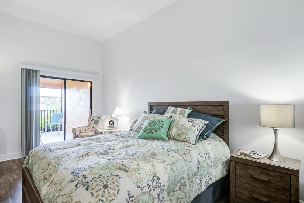 Private bedroom with sliding glass door at Truewood by Merrill, Port Charlotte in Port Charlotte, Florida.