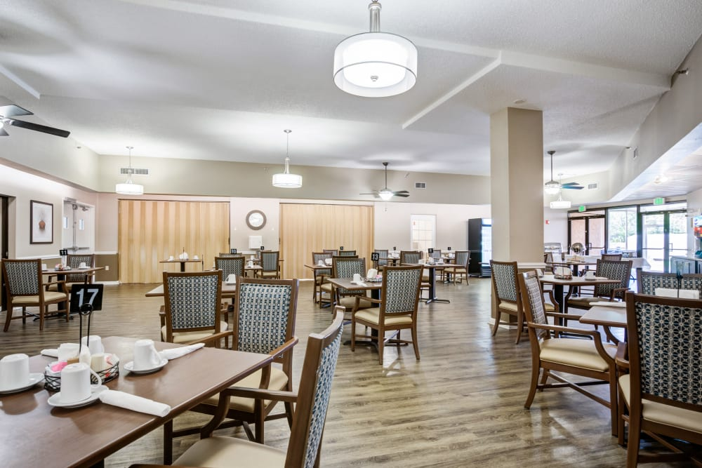 Dining room with tables and chairs at Truewood by Merrill, Port Charlotte in Port Charlotte, Florida.