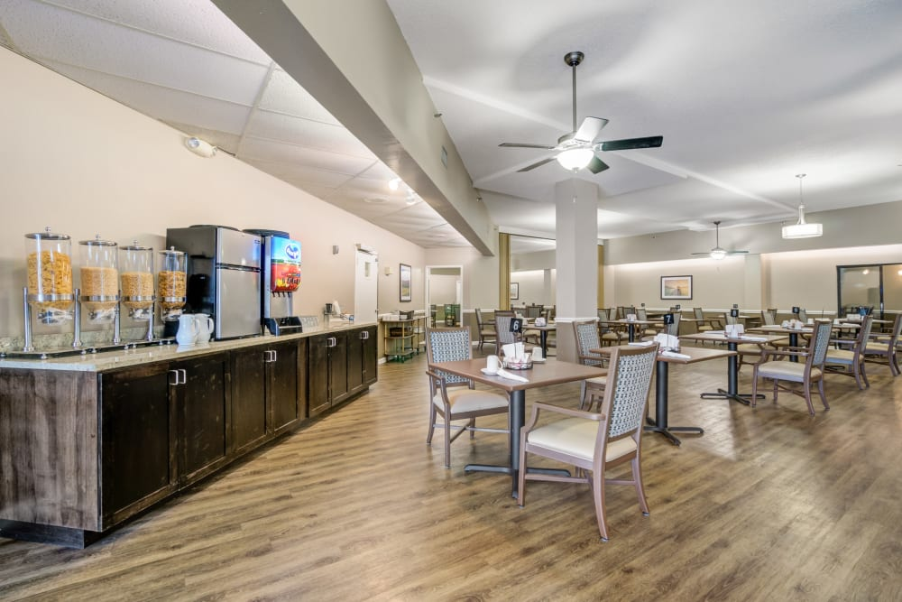 Drink station and dining room area at Truewood by Merrill, Port Charlotte in Port Charlotte, Florida.