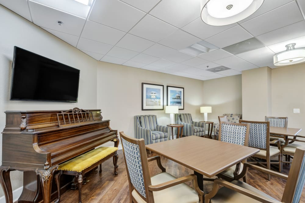 Activity room with piano at Truewood by Merrill, Port Charlotte in Port Charlotte, Florida.