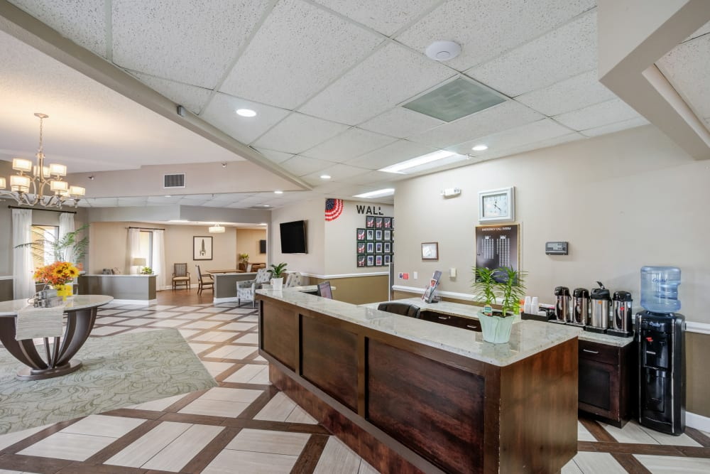 Front desk and lobby at Truewood by Merrill, Port Charlotte in Port Charlotte, Florida.