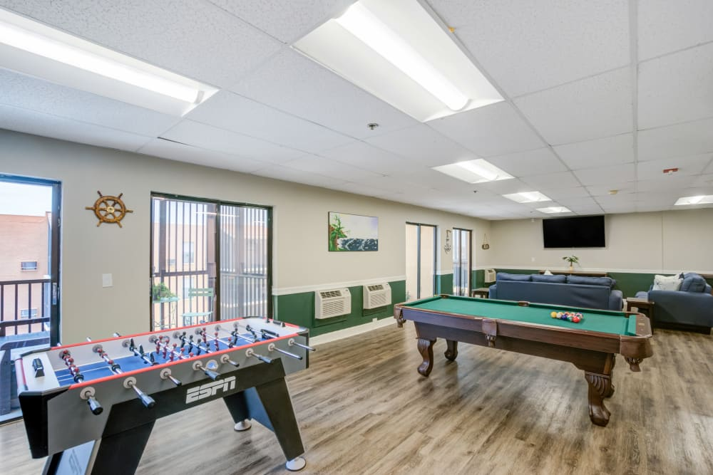 Billiards and foosball table in the clubhouse at Truewood by Merrill, Port Charlotte in Port Charlotte, Florida.
