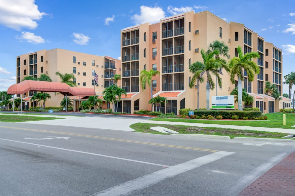 View of property buildings at Truewood by Merrill, Port Charlotte in Port Charlotte, Florida.