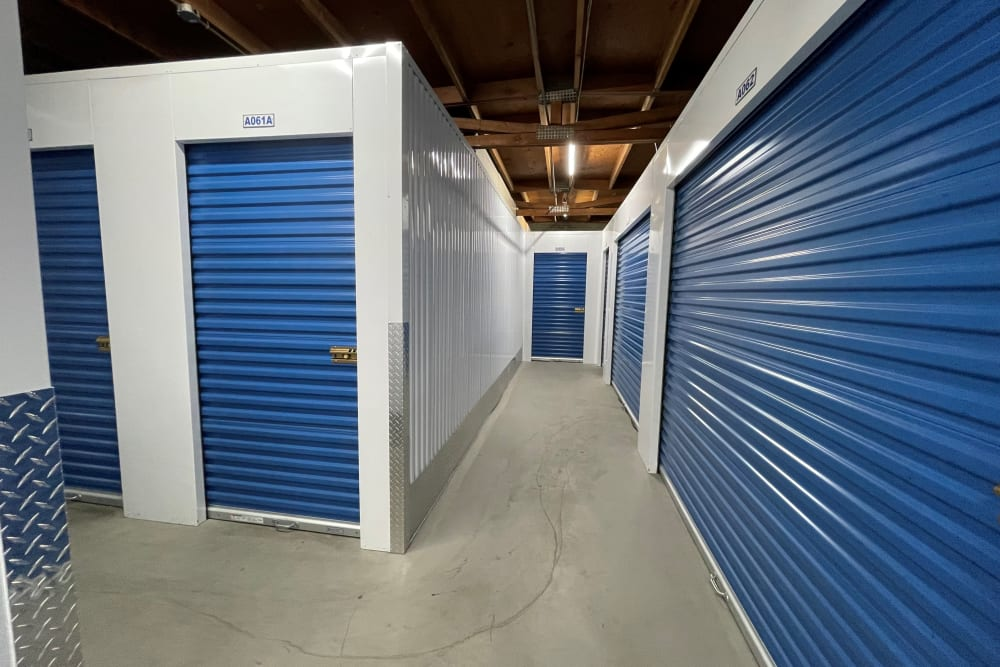 Indoor hallway access to storage units at Storage Solutions in Pomona, California