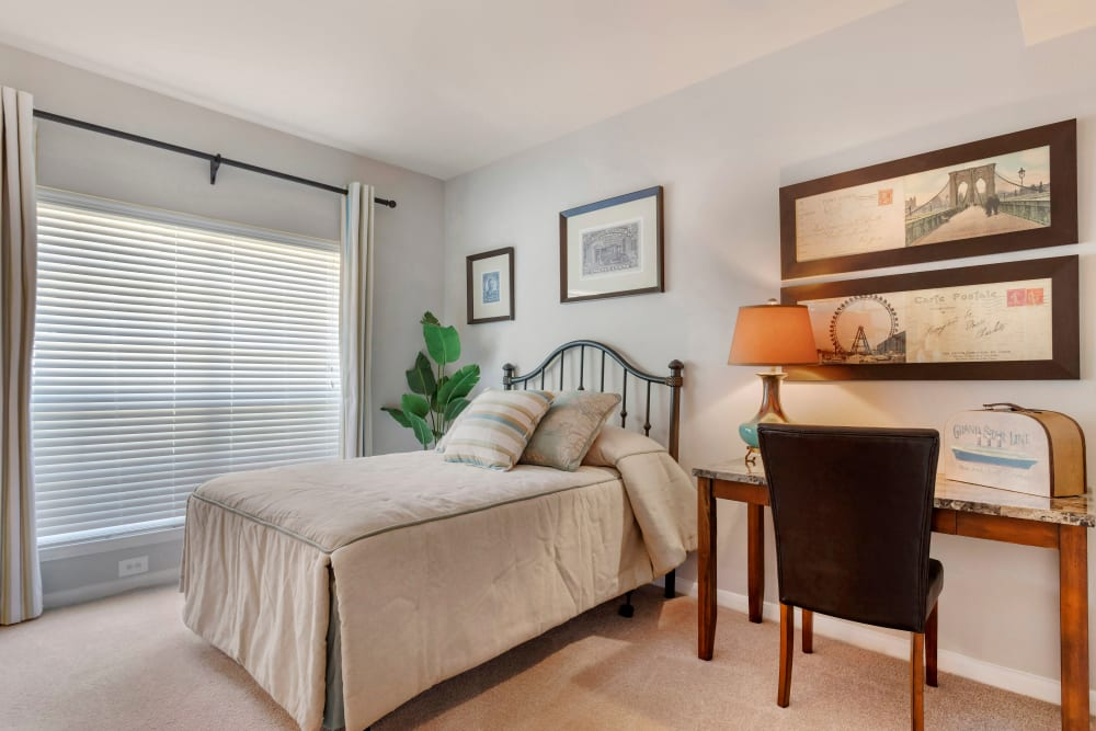 Model bedroom with a desk and large windows at Regency at First Colony in Sugar Land, Texas