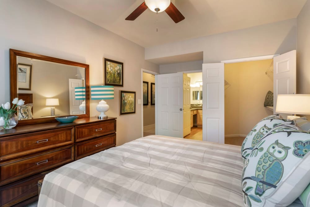 Model bedroom with ensuite bathroom and walk-in closet at Regency at First Colony in Sugar Land, Texas