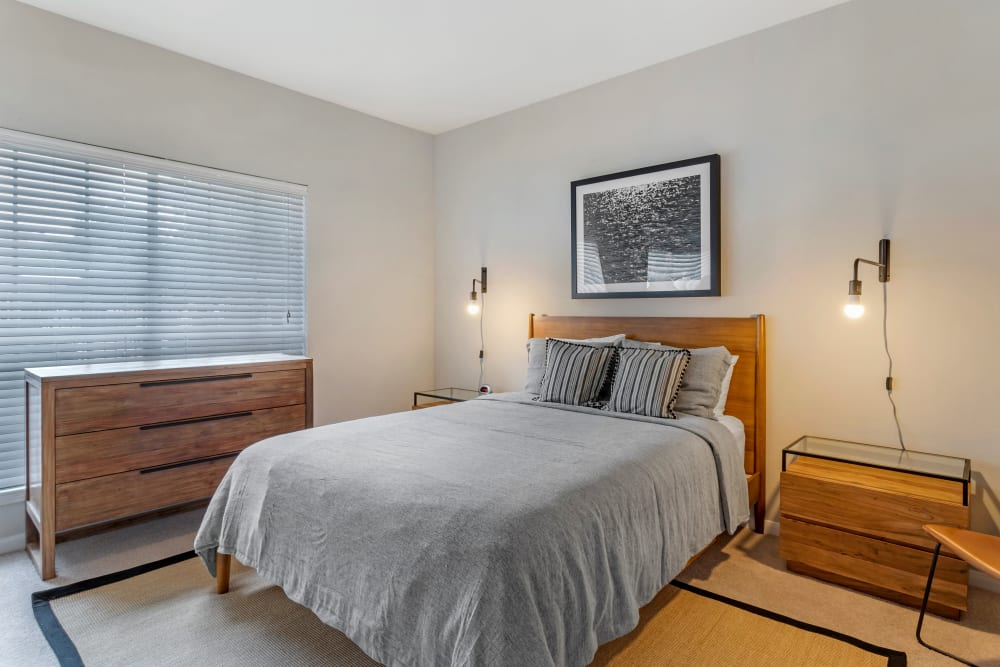 Large model bedroom with bedside tables and modern lighting at Regency at First Colony in Sugar Land, Texas