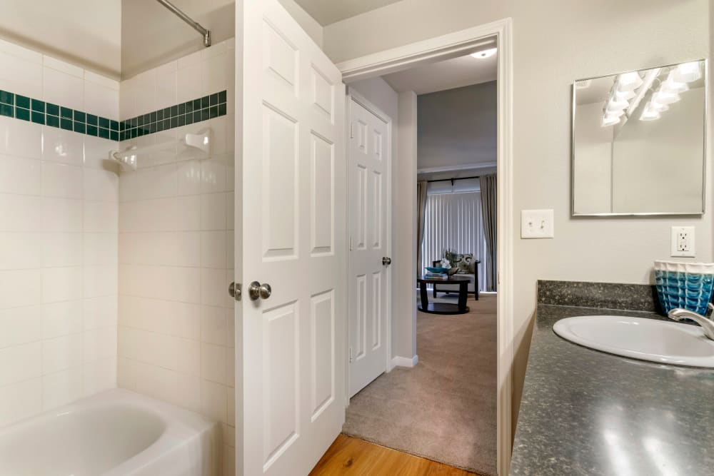 Bathroom with tiled shower and oval tub at Regency at First Colony in Sugar Land, Texas