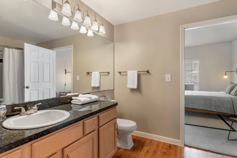 Model bathroom with oversized vanity and hardwood floors at Regency at First Colony in Sugar Land, Texas
