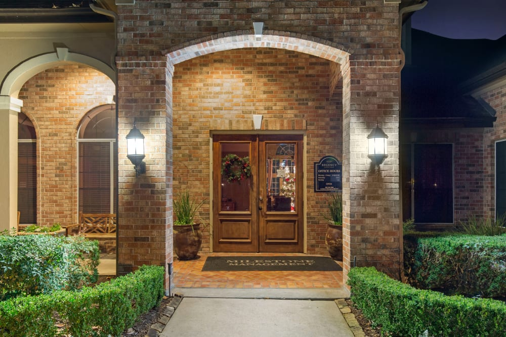 Well lit entrance to the office with hours posted at Regency at First Colony in Sugar Land, Texas