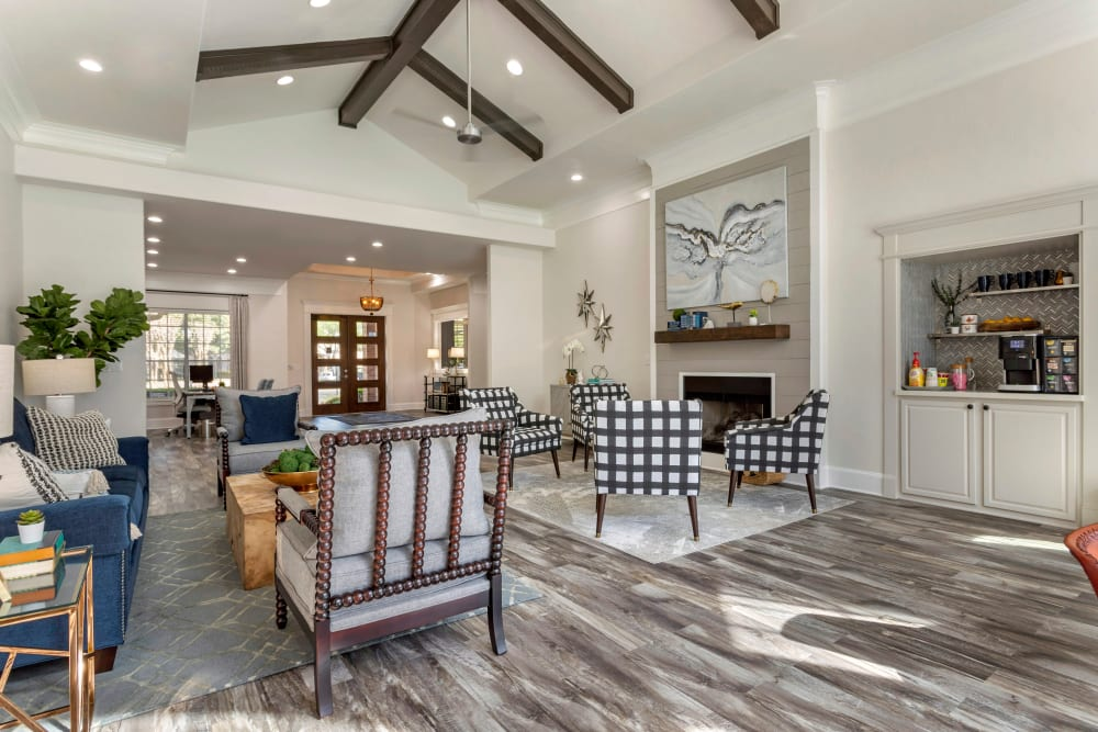 Beautiful resident clubhouse with large fireplace and coffeemaker at Regency at First Colony in Sugar Land, Texas