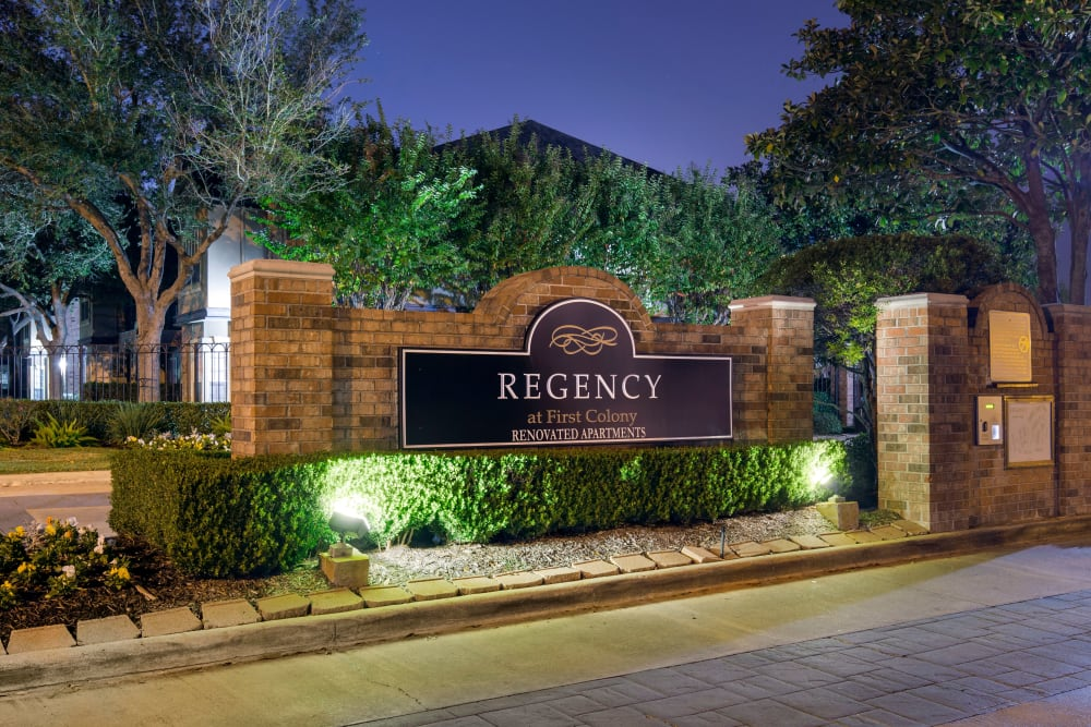 Well lit signage and keypad at the gated entrance to Regency at First Colony in Sugar Land, Texas