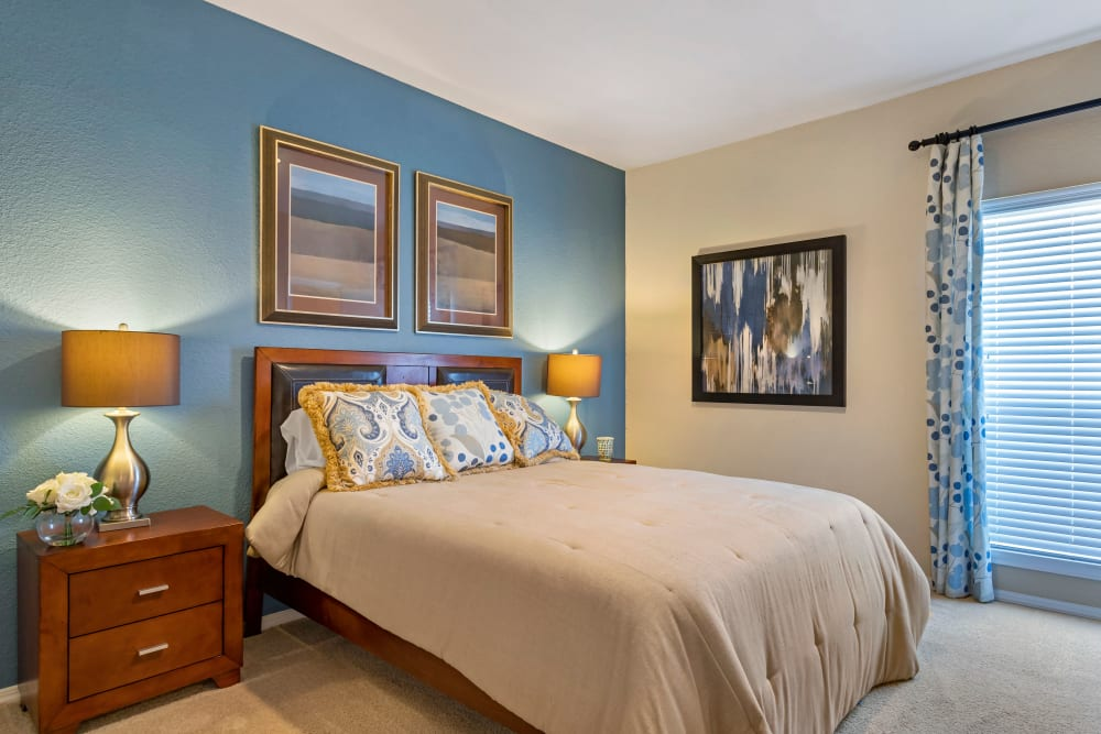 Well lit model bedroom with with plush carpeting at Foundations at River Crest & Lions Head in Sugar Land, Texas