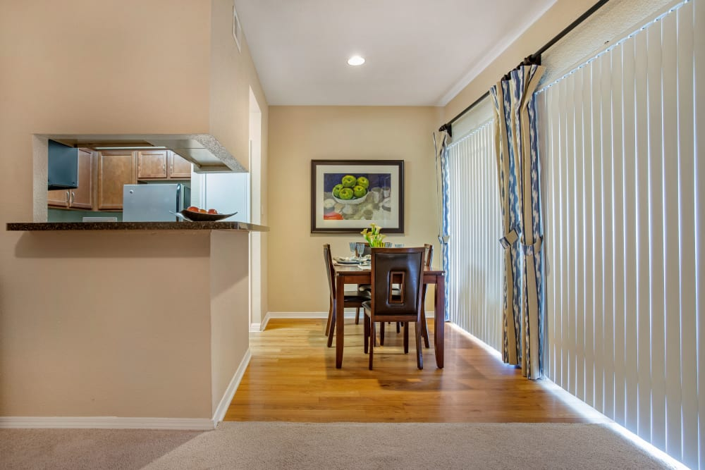 Dining area with pass-through to the kitchen in a model apartment home at Foundations at River Crest & Lions Head in Sugar Land, Texas