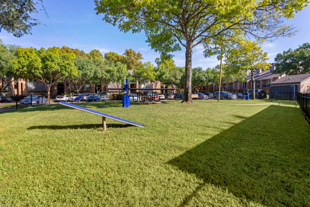 Large onsite off-leash bark park with agility equipment at Foundations at River Crest & Lions Head in Sugar Land, Texas