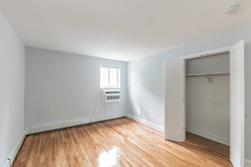 Cozy bedrooms with natural lighting at Eagle Rock Apartments at Carle Place in Carle Place, New York