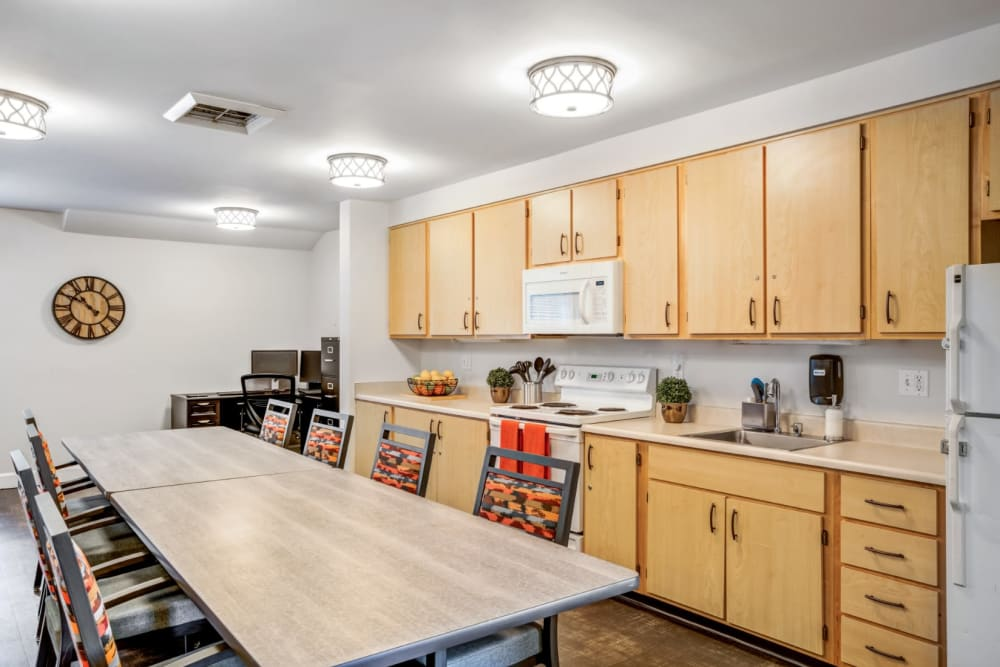 Kitchenette with a long table at Woodside Senior Living in Springfield, Oregon