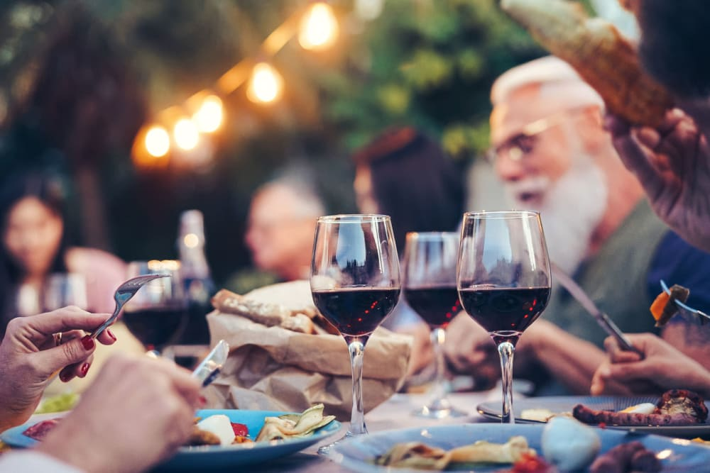 Friends gathered for a feast in the evening at one of our outside common areas at The Pointe at Siena Ridge in Davenport, Florida