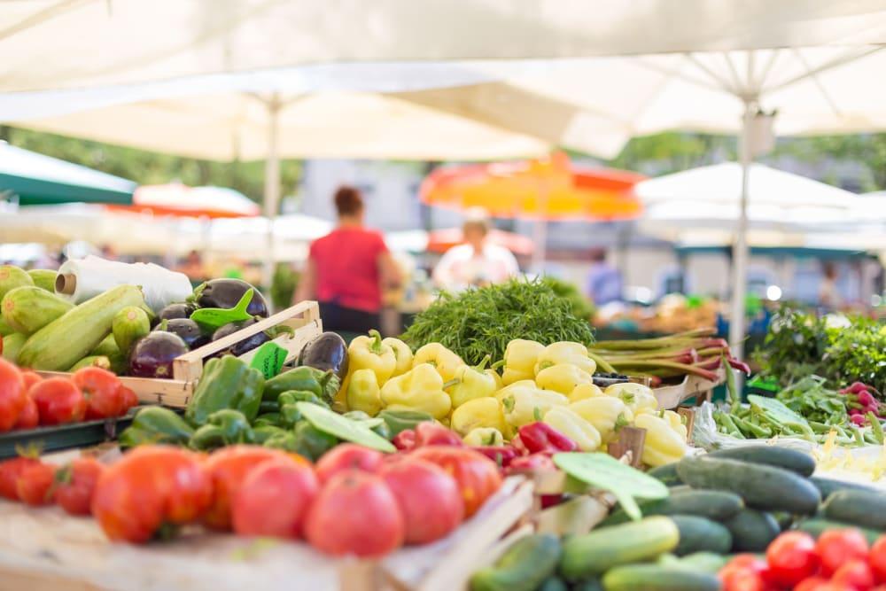 Farmers market featuring fresh produce near The Pointe at Siena Ridge in Davenport, Florida
