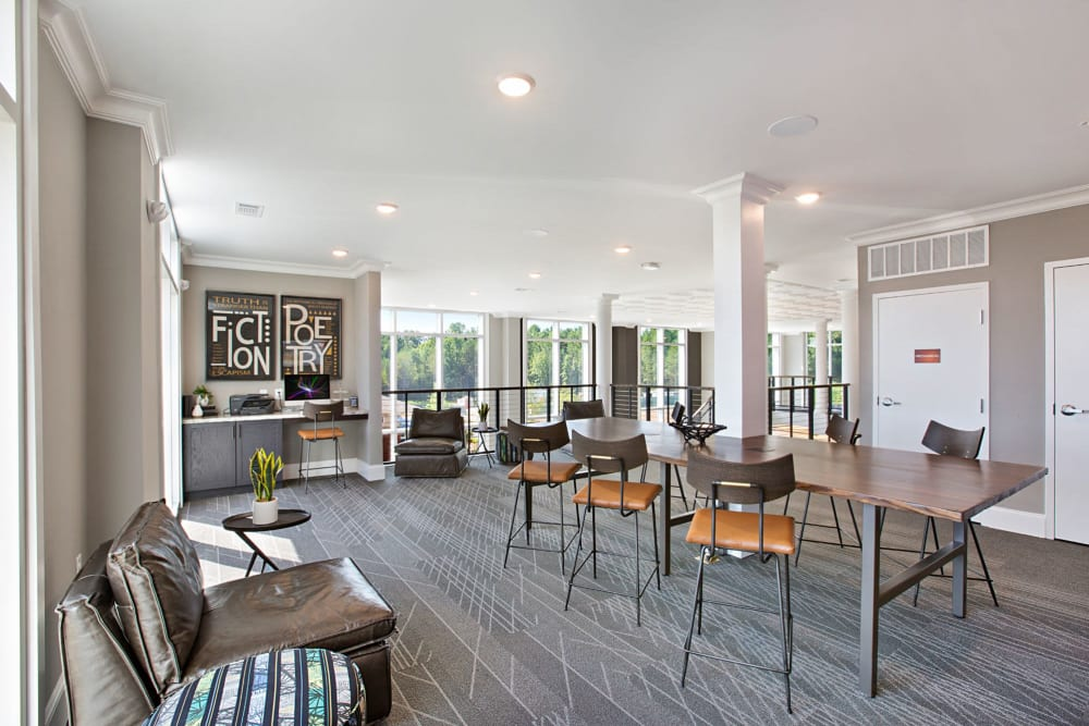 Clubhouse area with tons of seating and tables to work at at 8 Metro Station in Charlotte, North Carolina