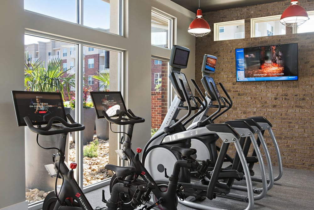 Fitness center cardio area with large windows that make for a great view while riding at 8 Metro Station in Charlotte, North Carolina