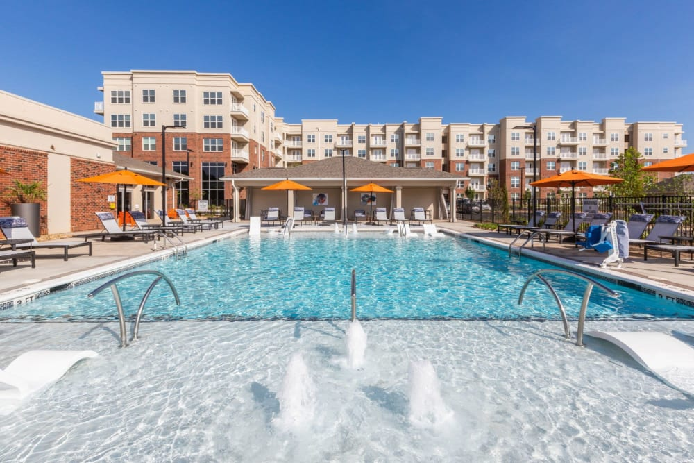 Refreshing swimming pool surrounded by tons of lounge chairs at 8 Metro Station in Charlotte, North Carolina