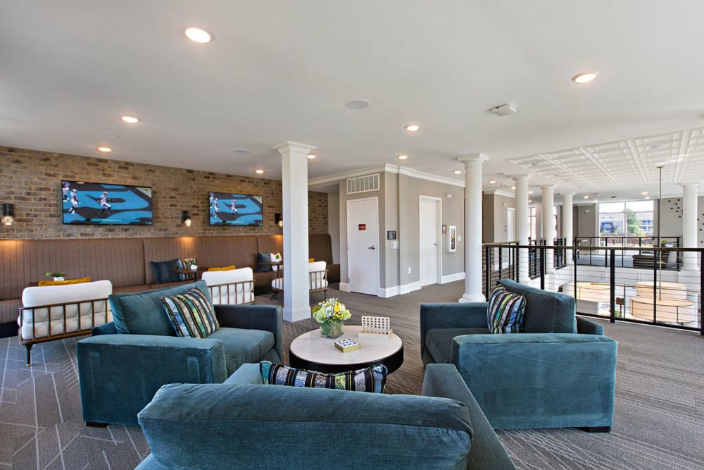 Upstairs lounge area with very cozy blue chairs to relax in at 8 Metro Station in Charlotte, North Carolina