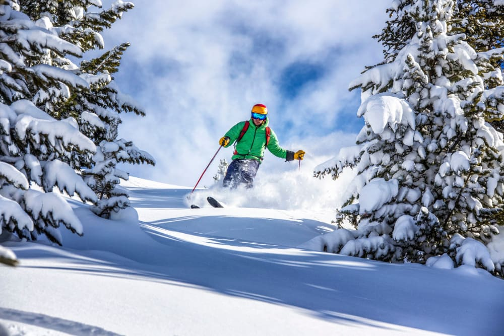 Resident getting some turns in on a beautiful powder day at Aspen near Fields on 15th Apartment Homes in Longmont, Colorado