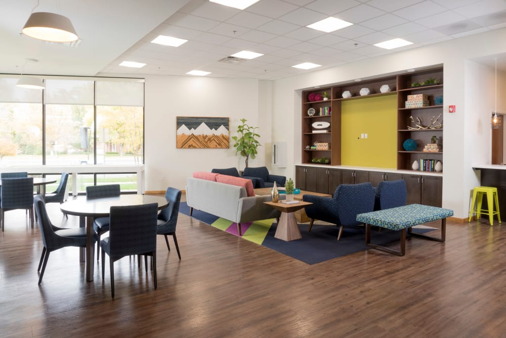 Clubhouse area with comfortable seating at Ash Street Apartments in Denver, Colorado