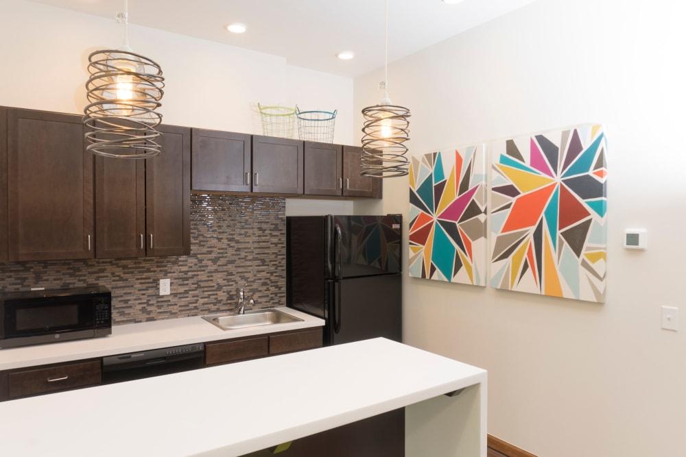 Kitchen bar area at Ash Street Apartments in Denver, Colorado