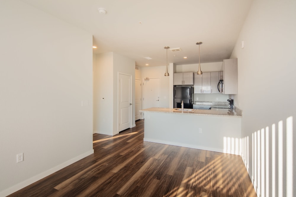 Model living room and kitchen at Eaton Street Apartments in Westminster, Colorado