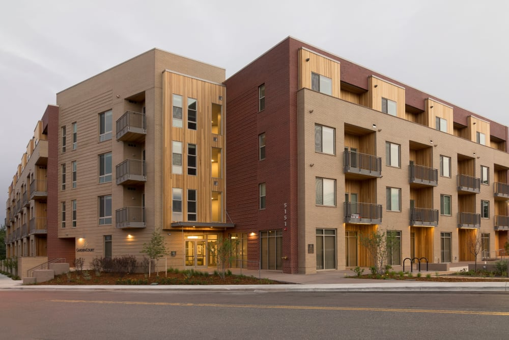 Exterior view of the building at Garden Court Apartments Yale Station in Denver, Colorado