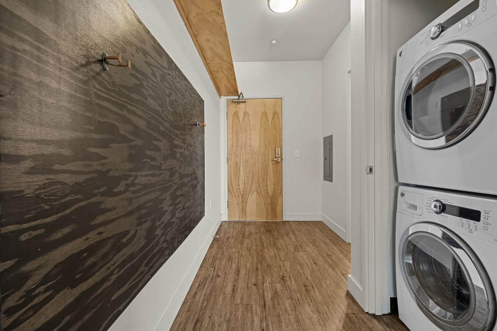 Hallway with washer and dryer at Anthem on 12th in Seattle, Washington