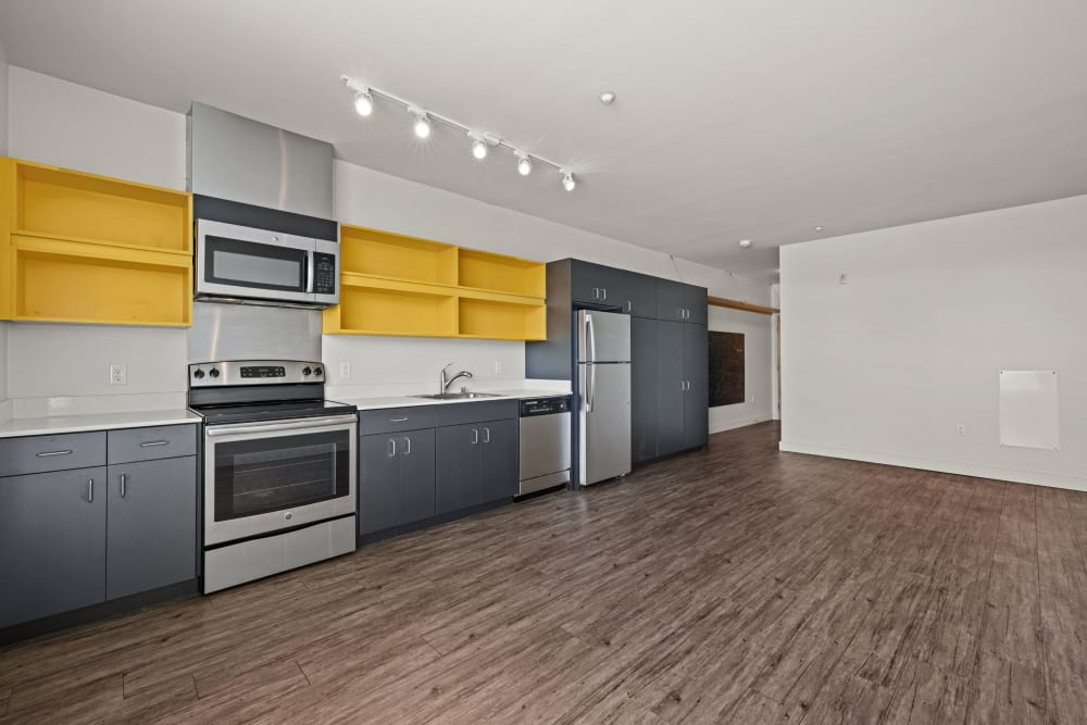 Kitchen with open cabinetry at Anthem on 12th in Seattle, Washington