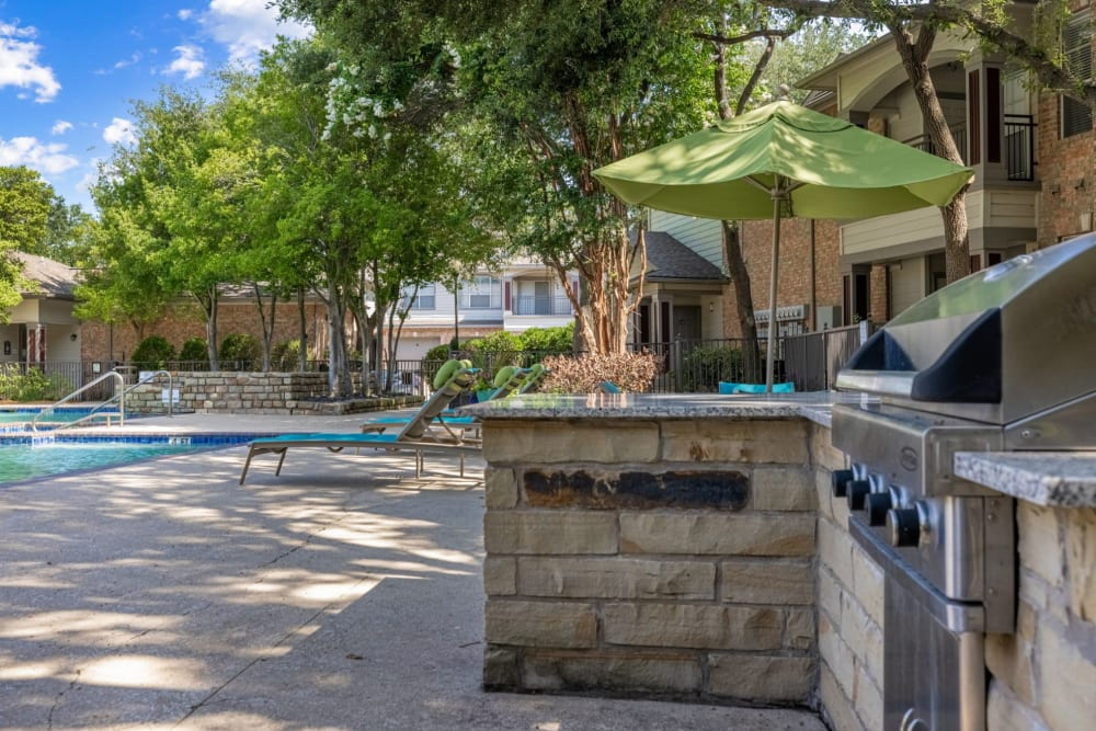 Grills near the pool at Brooks on Preston in Plano, Texas