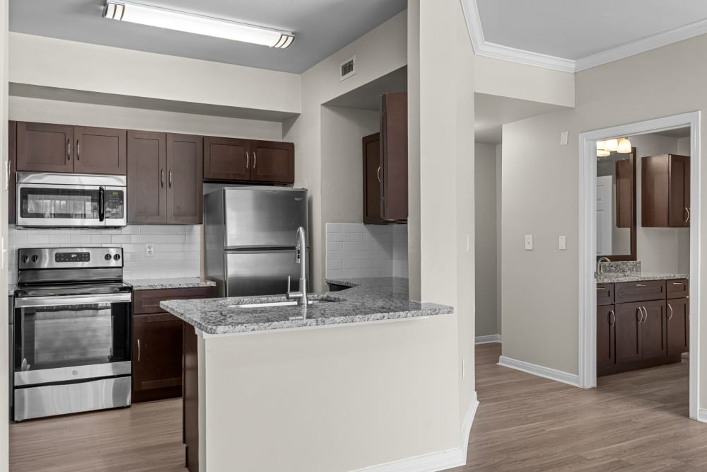Kitchen with wood style floors at Brooks on Preston in Plano, Texas