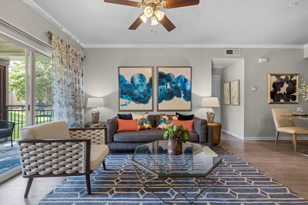 Living room with wood style floors at Brooks on Preston in Plano, Texas