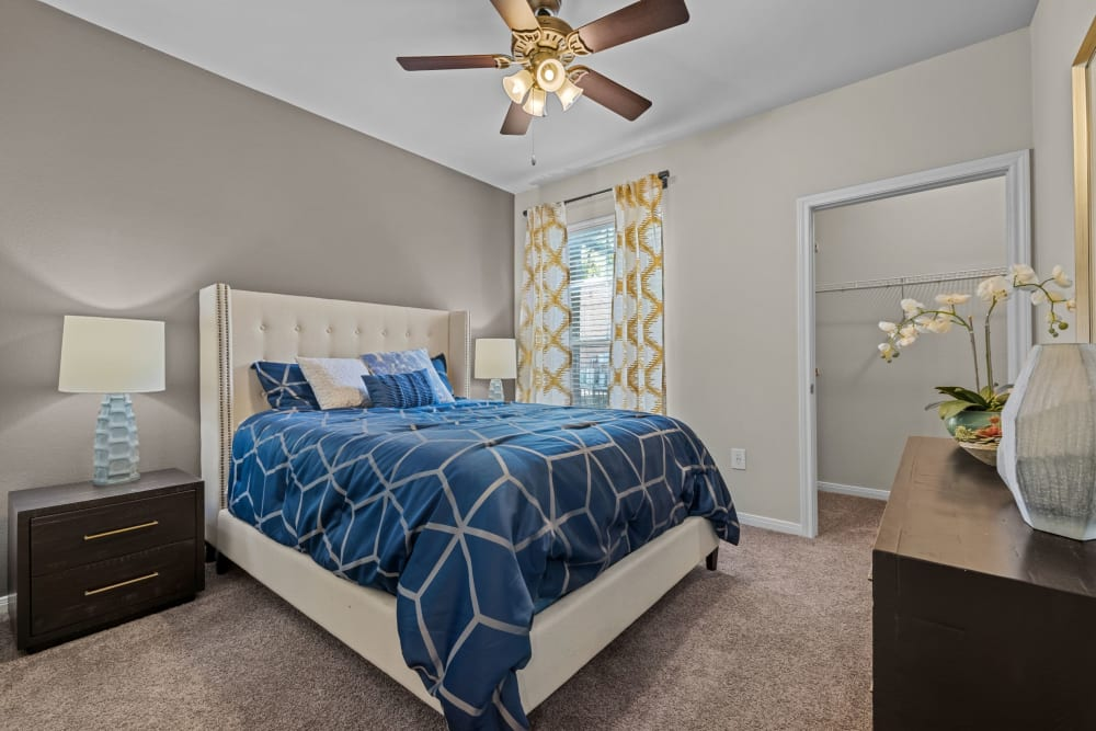 Spacious bedroom with carpet floors at Brooks on Preston in Plano, Texas