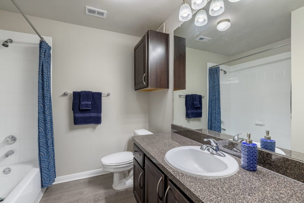 Granite style counters in the bathroom at Brooks on Preston in Plano, Texas