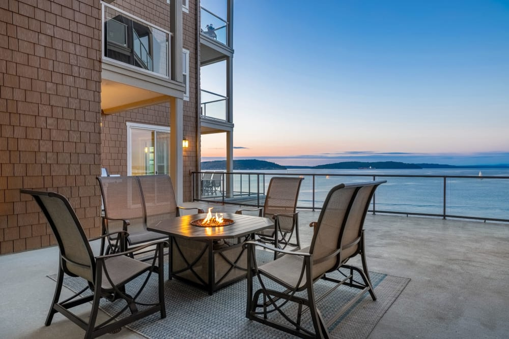 Table and a fire pit on a balcony at Copperline at Point Ruston in Tacoma, Washington