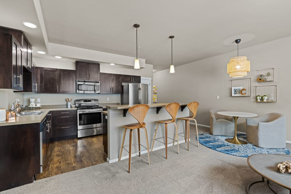Kitchen and living area at Copperline at Point Ruston in Tacoma, Washington