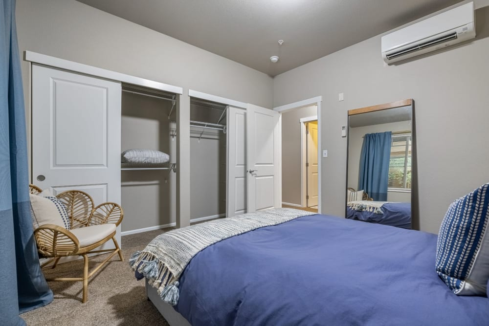 Bedroom with attached bathroom at Copperline at Point Ruston in Tacoma, Washington