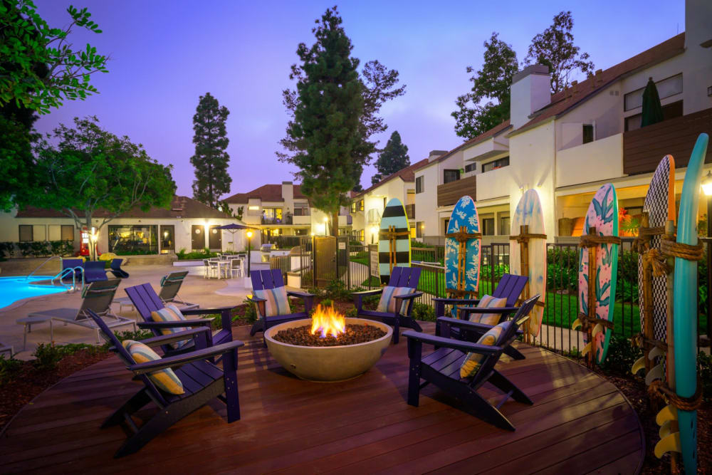 Incredible night view of the pool and lounge area surrounded by a cool design made of surfboards at Sendero Huntington Beach in Huntington Beach, California