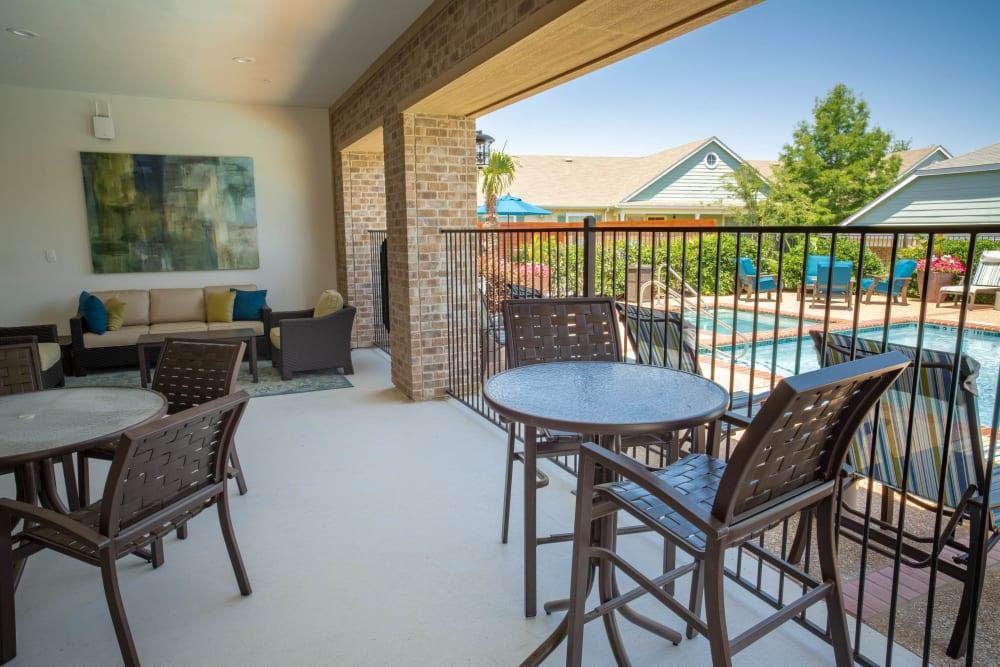 Lounging area near pool at Sunstone Village in Denton, Texas