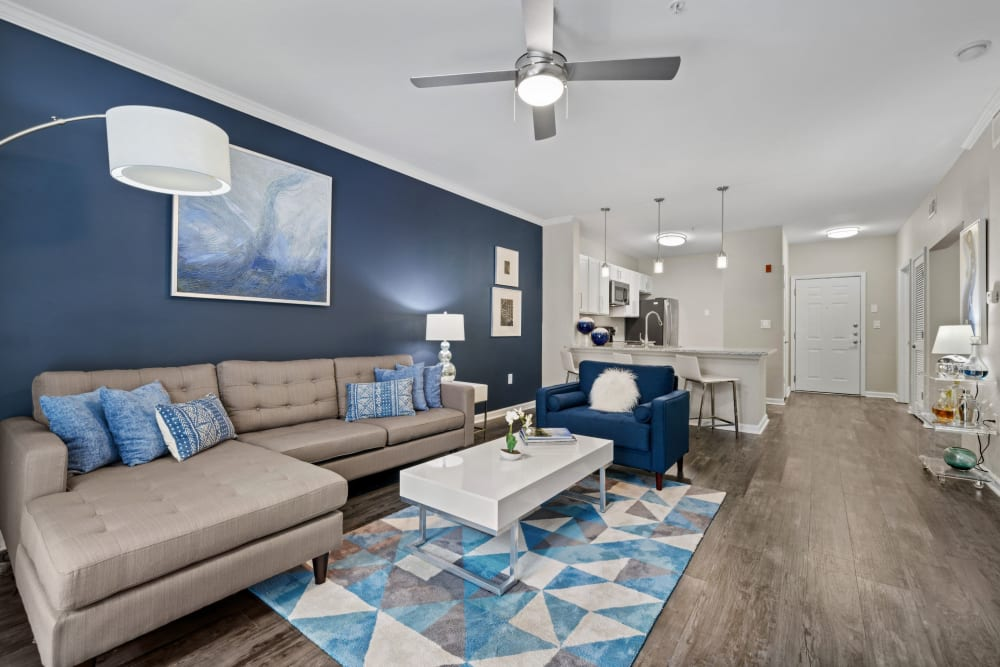 living room with a blue accent wall at Marq on Ponce in Atlanta, Georgia
